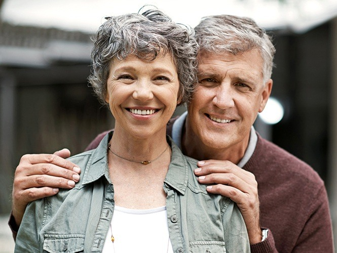 Older man and woman smiling together